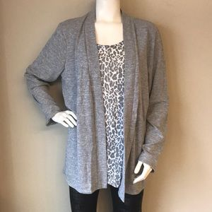 White stage woman's gray cardigan attached to top